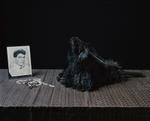 Justine Reyes: Still Life with Rosary Beads, Feather Duster and Father