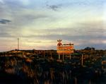 Steve Fitch: Sign on I-40 West of Tucumcari, New Mexico, July, 1990